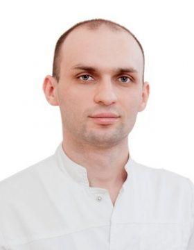 Бостанов Эльдар Альбертович хирург имплантолог