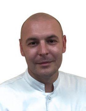 Крутиков Алексей Владимирович хирург имплантолог